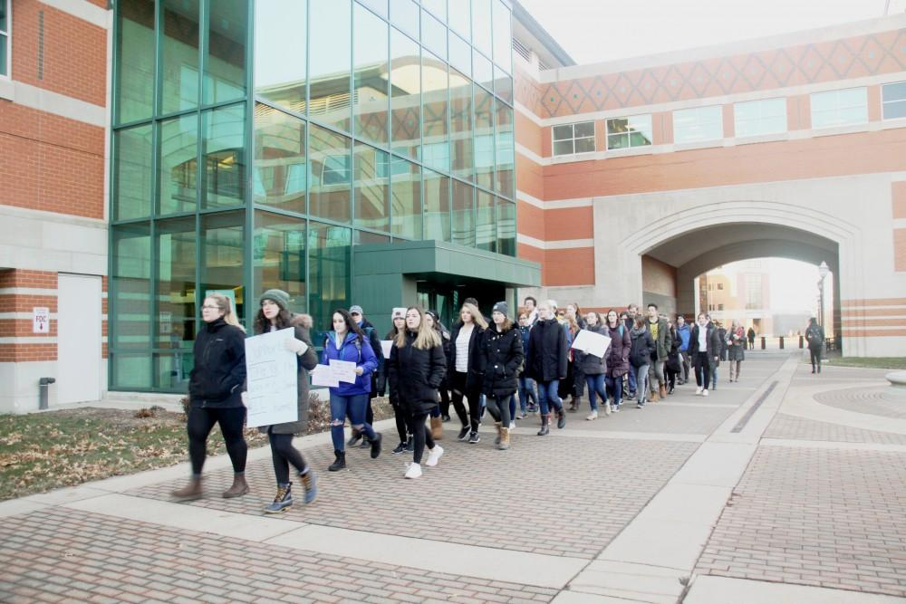Students silently walking for the Title XI Changes Protest on Grand Valley's campus this past Wednesday, January 9th. GVL / Emily Modloff
