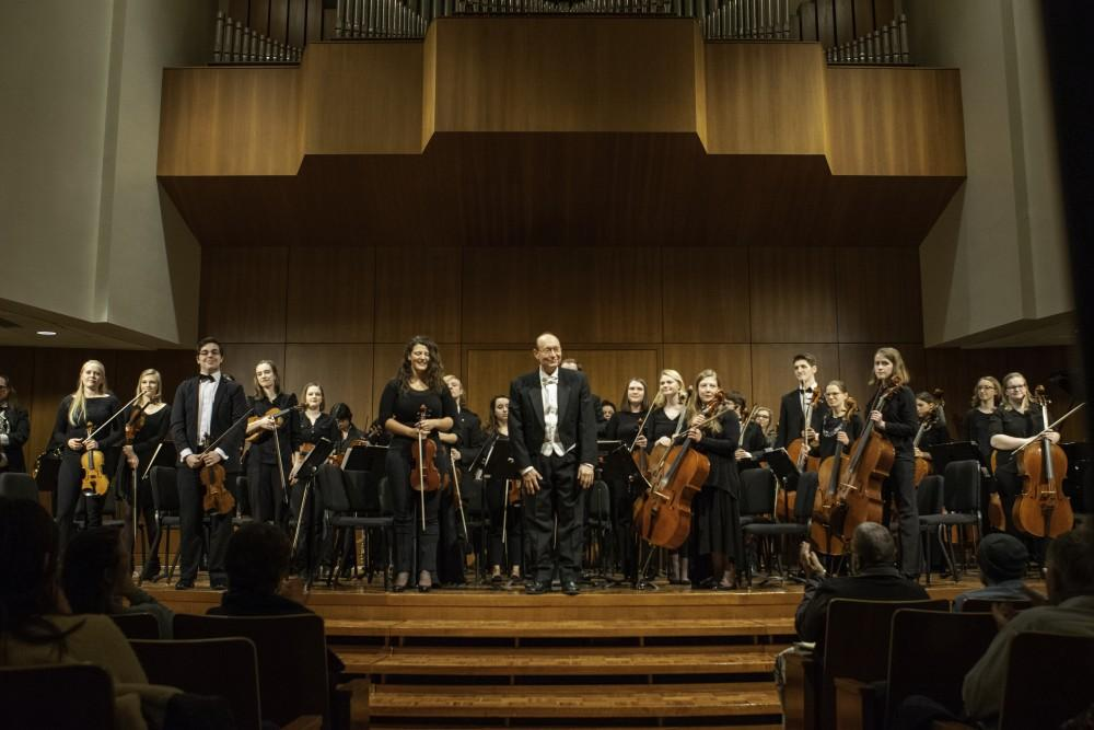 <p>Grand Valley's Orchestra performing February 19 in the Cook-DeWitt Center under the direction of Henry Duitman. GVL / Andrew Nyhof</p>