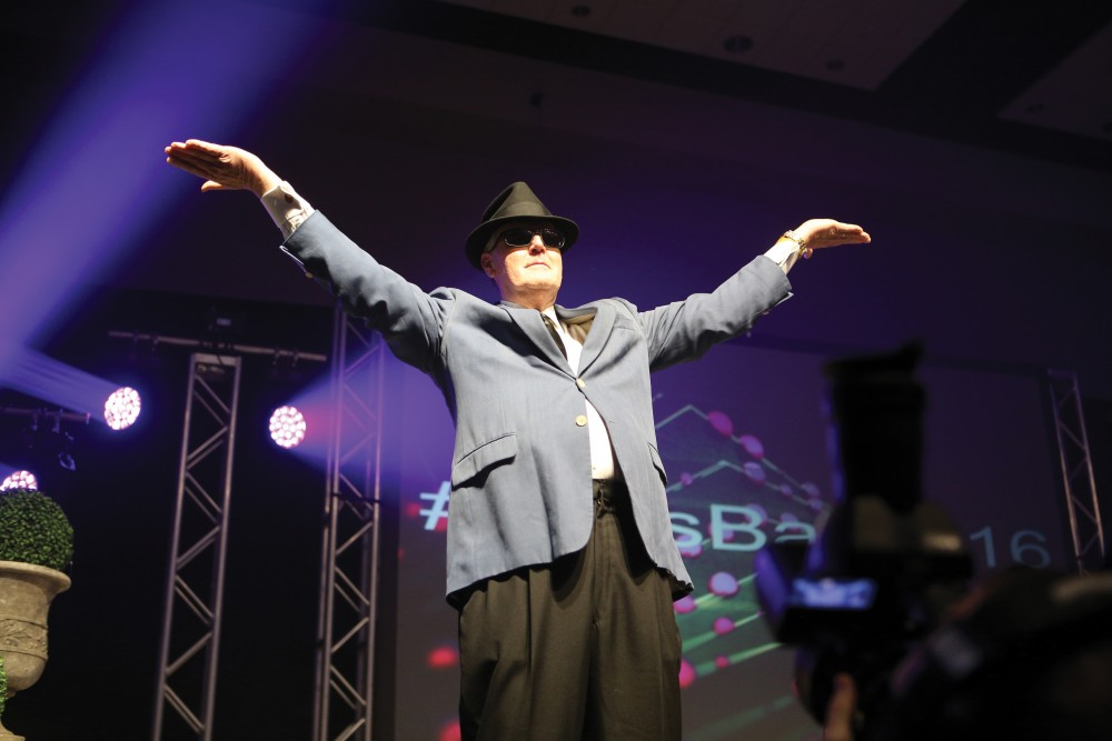 President Thomas Haas performs a blast from the past for the Laker crowd during the Presidents Ball on Friday Feb. 5, 2016. GVL / Archive
