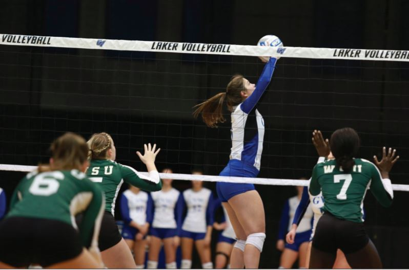 GVSU's Frankie Cavallaro sets the ball for a teammate in a game from last season. Cavallaro is one of only two seniors on the 2019-20 women's volleyball team. COURTESY | GVSU