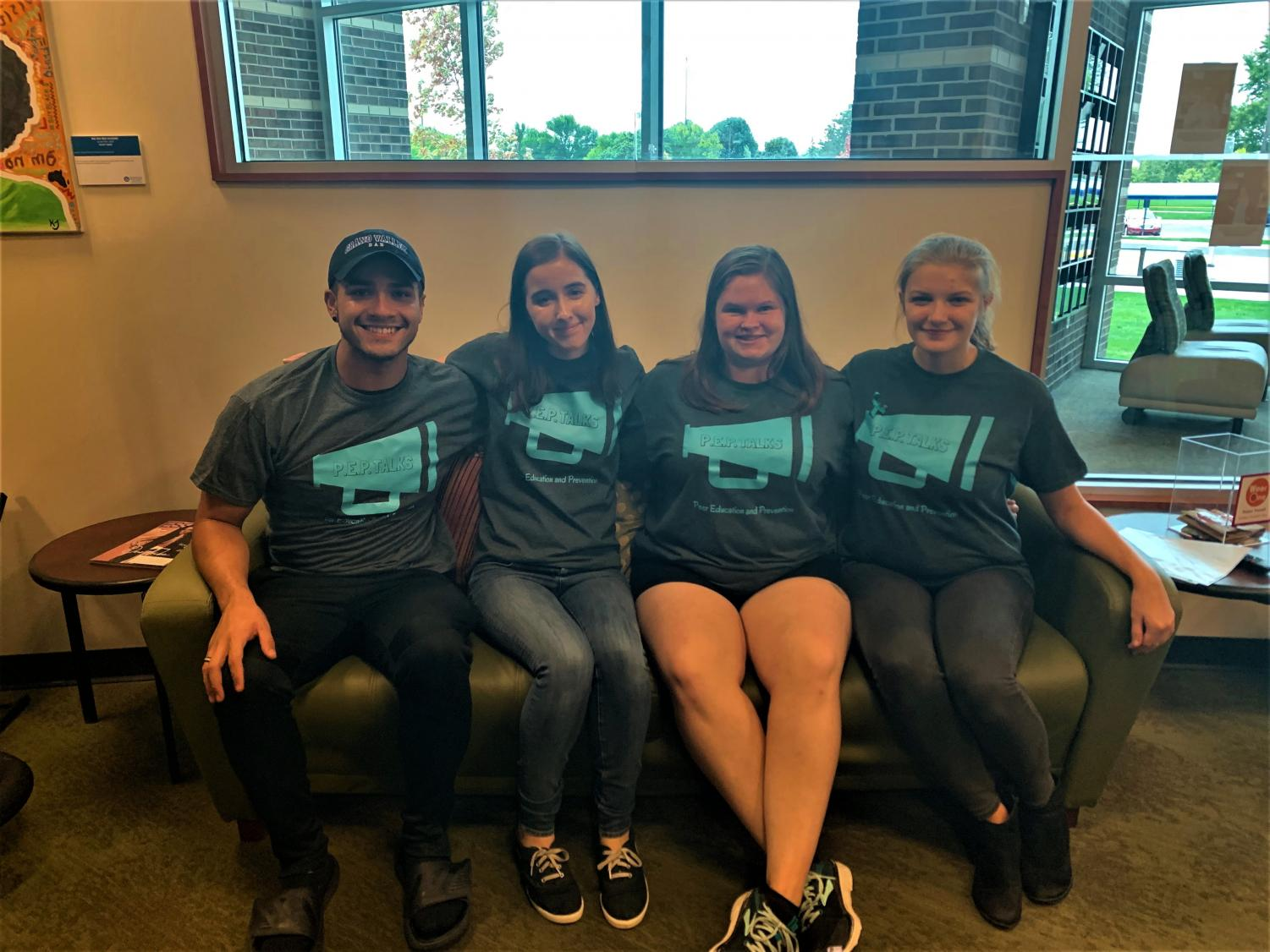 Four of Grand Valley's Peer Educators. From left to right: Lansing Sanchez-Castillo, Isabella Haskin, Emily Uhlarik, and Emma Bruns. COURTESY \ Caitlyn Cubberly