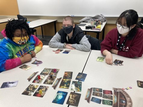 "The club playing ""Mysterium,"" a co-op game about getting a message across using pictures as clues.(Courtesy Emily Booms)"