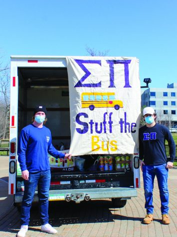 "Sigma Pi ""Stuffs the Bus"" to feed GV community"